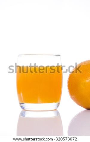 Glass of orange juice on white background - stock photo