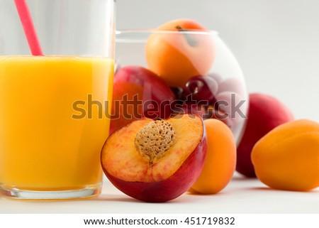 Glass of orange juice with fruit isolated on white - stock photo