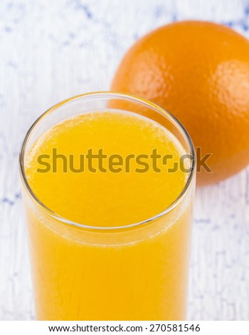Glass of orange juice with pulp