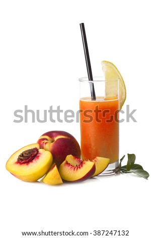 Glass of peach juice isolated on white - stock photo