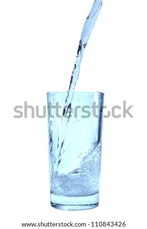 Glass of pouring water isolated on white .