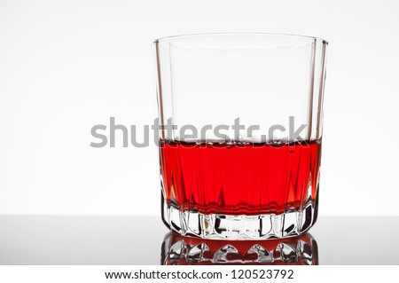 Glass of red juice - stock photo