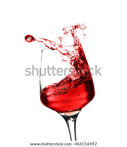 Glass of red splashing wine isolated on white