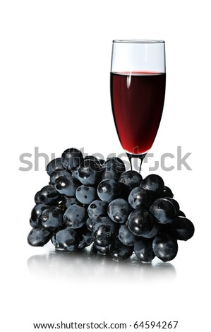 Glass of red wine and bunch of grapes isolated on white background. - stock photo