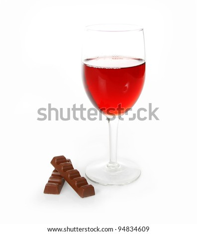 glass of red wine and chocolate on white background - stock photo