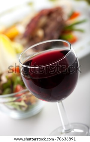 glass of red wine and dinner - stock photo