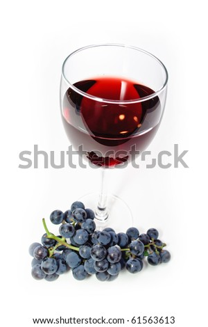 Glass of red wine and grape branch isolated on white background