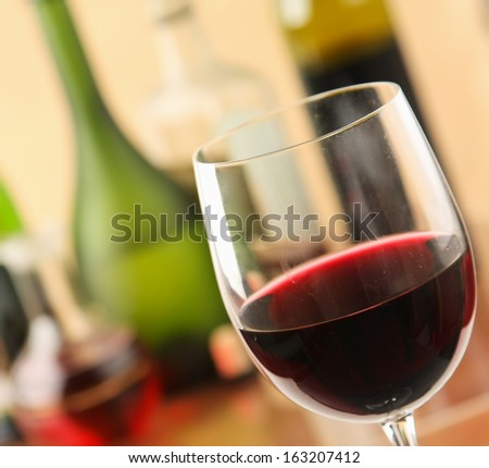 glass of red wine and the wine bottle - stock photo