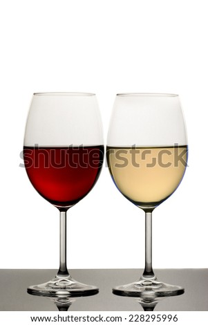 Glass of Red Wine and White Wine against White Background - stock photo