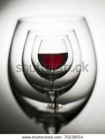 Glass of red wine close up abstract shoot - stock photo