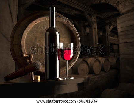 glass of red wine in a wine cellar - stock photo