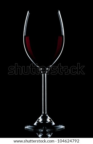 Glass of red wine on a black background. - stock photo