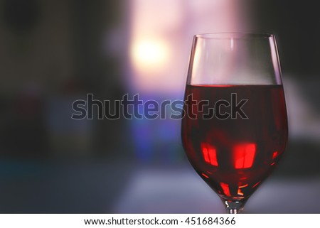 Glass of red wine on blurred background - stock photo