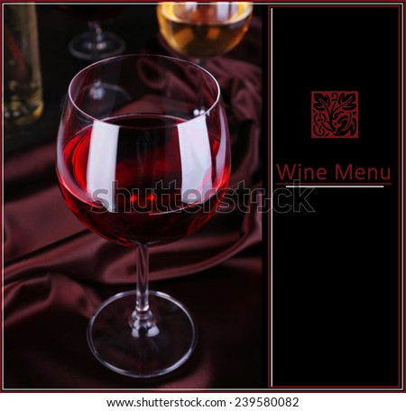 Glass of red wine on dark fabric background with space for text, Wine Menu - stock photo