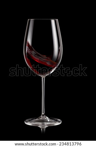 Glass of red wine swirl - stock photo