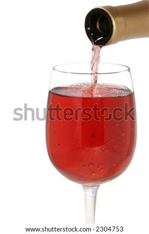 Glass of Red Wine that is being filled from a bottle of which the neck is visible - isolated on white background - stock photo