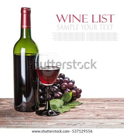 glass of red wine with bottle and grapes isolated on white background. for example text and easily removed