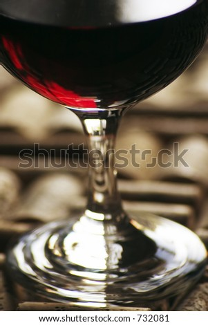 glass of red wine with corks
