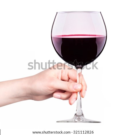 Glass of red wine with splashes in hand isolated on a white background