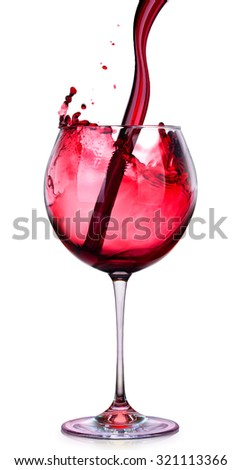 Glass of red wine with splashes isolated on a white background