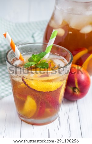 Glass of refreshing homemade nectarine iced tea - stock photo