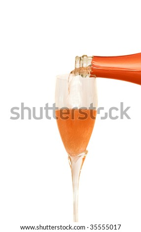 Glass of rose champagne and bottle - stock photo