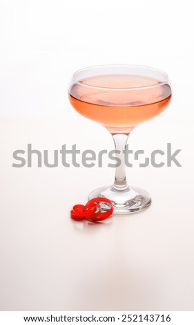 Glass of  Rose champagne on a white background - stock photo