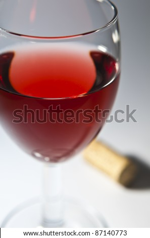Glass of rose wine with a cork - stock photo