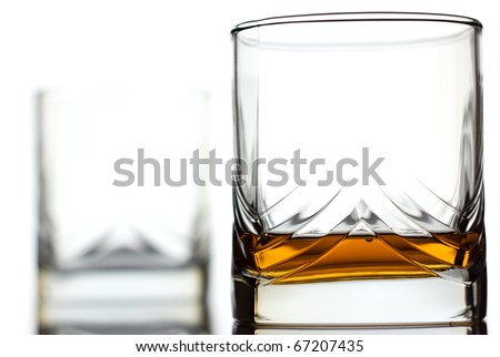 Glass of scotch whiskey and empty glass on background - stock photo