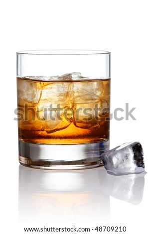 Glass of scotch whiskey and ice with clipping path - stock photo