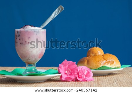 Glass of sicilian granita with a typical warm brioche
