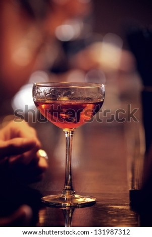 Glass of sparkling red wine on the bar's counter - stock photo