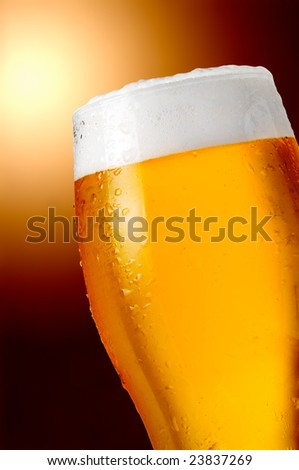 Glass of strong and cold beer with water drops