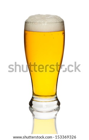 Glass of tasty and fresh beer isolated on a white background - stock photo