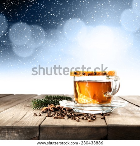 glass of tea and winter  - stock photo