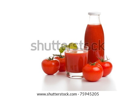 Glass of tomato juice, a bottle and tomatoes