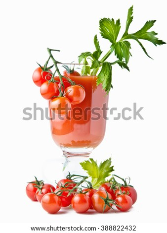Glass of tomato juice with celery leaf and tomato's.