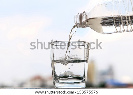 Glass of water and bottle - stock photo