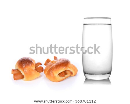 glass of water and Bread stuffed with hotdog on white background - stock photo