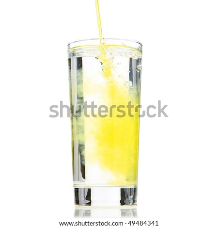 Glass of water been diluted to orange drink - stock photo