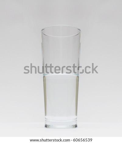 Glass of water - half full / half empty - stock photo