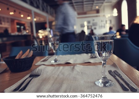 glass of water in the interior of the restaurant - stock photo