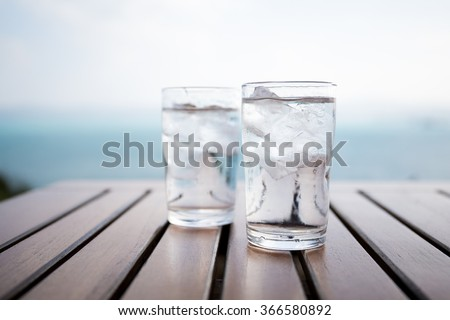 Glass of water on a table in a restaurant - stock photo