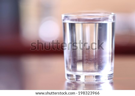 Glass of water on table close-up - stock photo