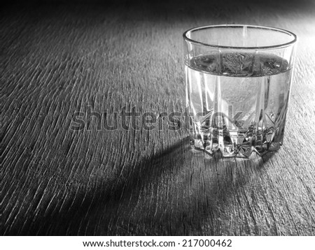 Glass of water on wooden background - stock photo