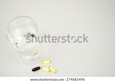 Glass of water to drink the tablets - stock photo