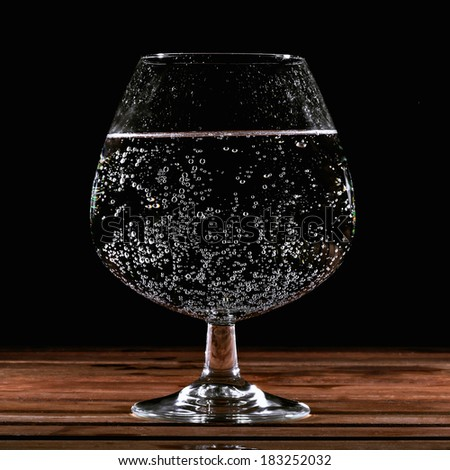 Glass of water with carbonation. - stock photo
