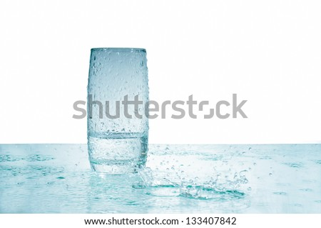Glass of water with drops on white  background - stock photo