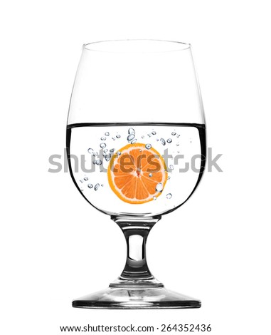 Glass of water with grapefruit -concept - stock photo