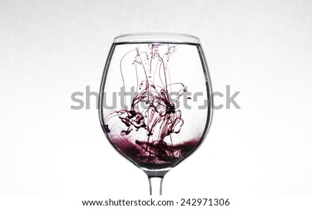 glass of water with injected ink - stock photo